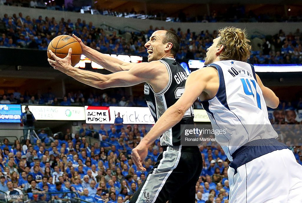Manu Ginobili #20 of the San Antonio Spurs takes a shot against Dirk Nowitzki #41 of the Dallas Mavericks in Game Four of the Western Conference Quarterfinals during the 2014 NBA Playoffs at American Airlines Center on April 28, 2014 in Dallas, Texas.