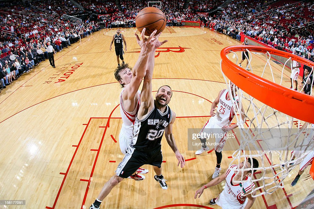 Manu Ginobili #20 of the San Antonio Spurs tries for a rebound against <a gi-track='captionPersonalityLinkClicked' href=/galleries/search?phrase=Omer+Asik&family=editorial&specificpeople=4946055 ng-click='$event.stopPropagation()'>Omer Asik</a> #3 of the Houston Rockets on December 10, 2012 at the Toyota Center in Houston, Texas.