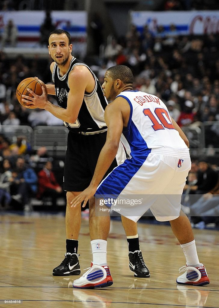 Manu Ginobili #20 of the San Antonio Spurs waits to pass in front of <a gi-track='captionPersonalityLinkClicked' href=/galleries/search?phrase=Eric+Gordon&family=editorial&specificpeople=4212733 ng-click='$event.stopPropagation()'>Eric Gordon</a> #10 of the Los Angeles Clippers at Staples Center on December 13, 2009 in Los Angeles, California.