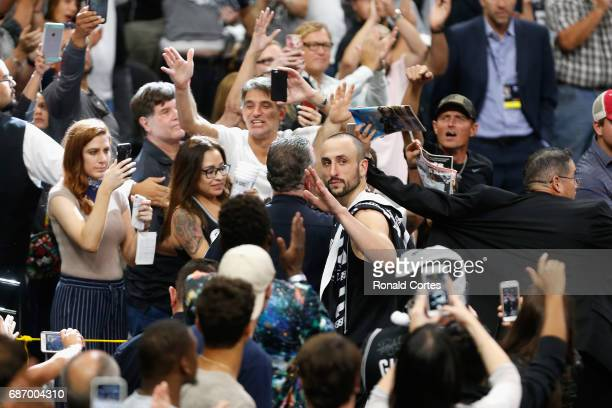 Manu Ginobili of the San Antonio Spurs waves as he leaves the court after the Golden State Warriors defeated the San Antonio Spurs 129115 in Game...