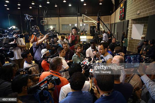 Manu Ginobili of the San Antonio Spurss speaks to the media on a practice day following Game One of the 2014 NBA Finals against the Miami Heat at the...