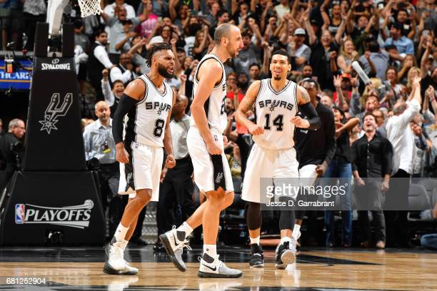 Manu Ginobili Patty Mills and Danny Green of the San Antonio Spurs celebrate after their victory against the Houston Rockets during Game Five of the...