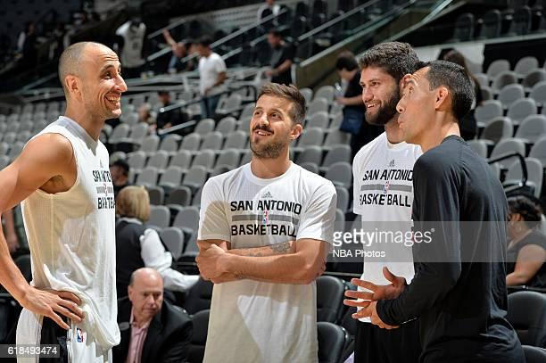 Manu Ginobili talks with Nicolas Laprovittola and Patricio Garino of the San Antonio Spurs before a preseason game against the Houston Rockets on...