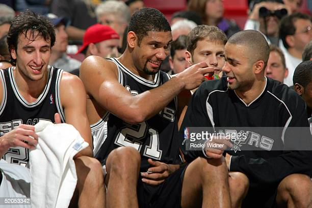 Manu Ginobili Tim Duncan and Tony Parker of the San Antonio Spurs enjoy a victory over the Sacramento Kings on January 23 2005 at Arco Arena in...