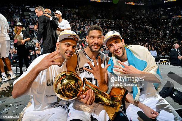 Manu Ginobili Tony Parker and Tim Duncan of the San Antonio Spurs celebrate with the Larry O'Brien trophy after defeating the Miami Heat to win the...