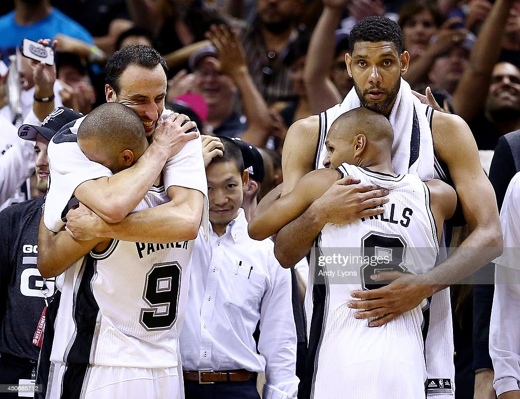 Manu Ginobili Tony Parker Patty Mills and Tim Duncan of the San Antonio Spurs celebrate on the bench in the closing minutes of Game Five of the 2014...