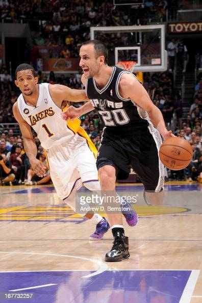 Manu Gunobili of the San Antonio Spurs drives ahead of Darius Morris of the Los Angeles Lakers at Staples Center in Game Four of the Western...
