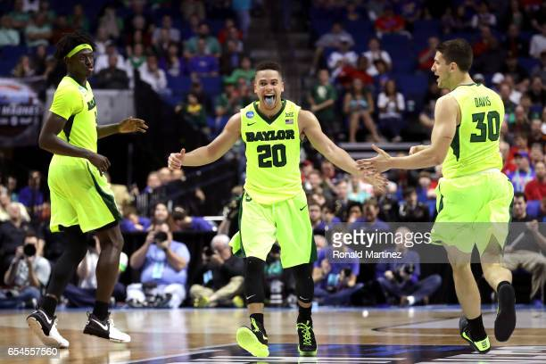 Manu Lecomte of the Baylor Bears celebrates with teammates after defeating the New Mexico State Aggies during the first round of the 2017 NCAA Men's...