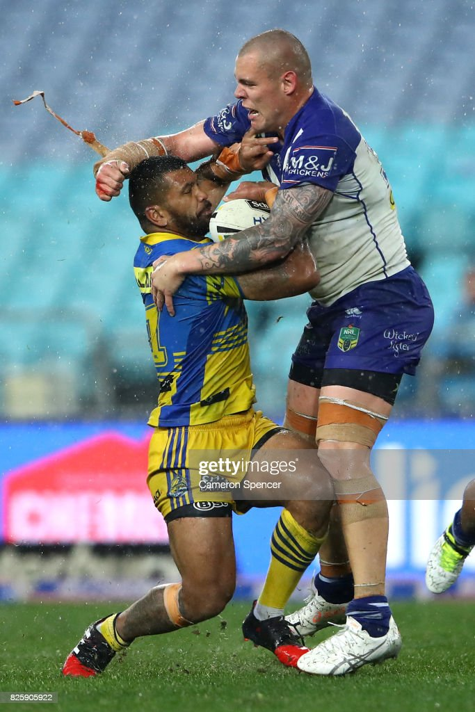 Manu Ma'u of the Eels is tackled by David Klemmer of the Bulldogs during the round 22 NRL match between the Canterbury Bulldogs and the Parramatta Eels at ANZ Stadium on August 3, 2017 in Sydney, Australia.