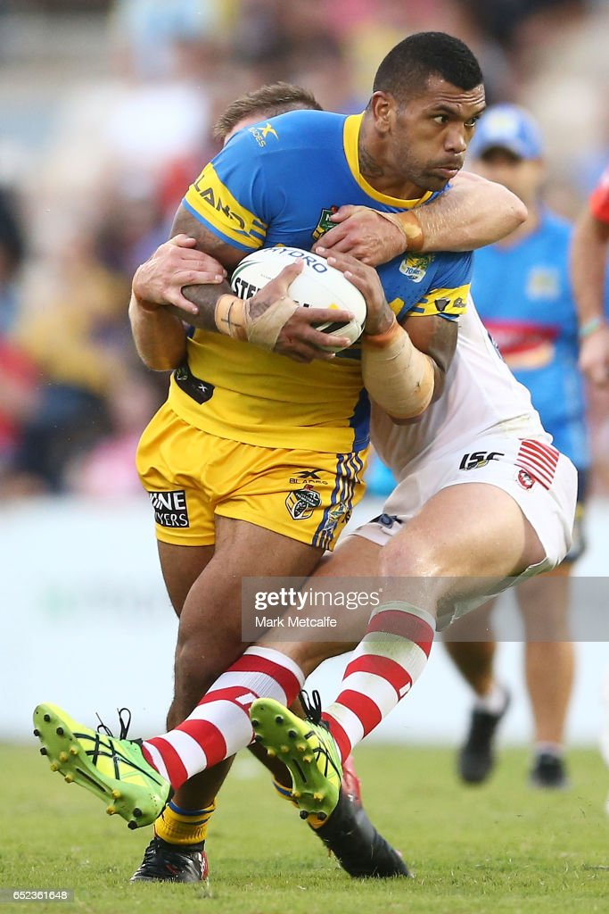 Manu Ma'u of the Eels is tackled by Josh McCrone of the Dragons during the round two NRL match between the St George Illawarra Dragons and the Parramatta Eels at WIN Stadium on March 12, 2017 in Wollongong, Australia.