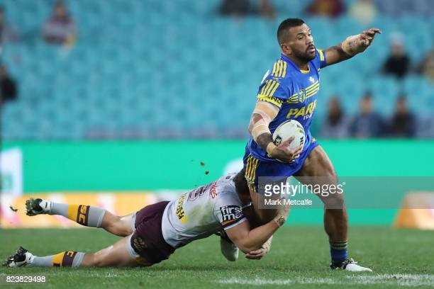 Manu Ma'u of the Eels is tackled during the round 21 NRL match between the Parramatta Eels and the Brisbane Broncos at ANZ Stadium on July 28 2017 in...