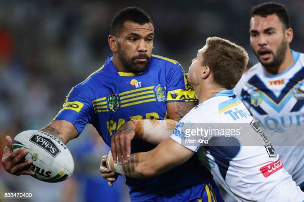 Manu Ma'u of the Eels offloads the ball in a tackle during the round 24 NRL match between the Parramatta Eels and the Gold Coast Titans at ANZ...