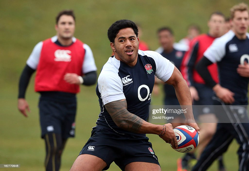 Manu Tuialgi passes the ball during the England training session held at Pennyhill Park on February 26, 2013 in Bagshot, England.