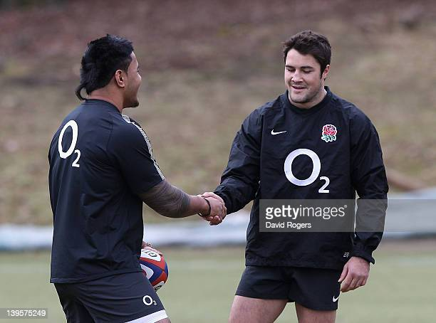Manu Tuilagi and Brad Barritt shake hands during the England training session held at Pennyhill Park on February 21 2012 in Bagshot England