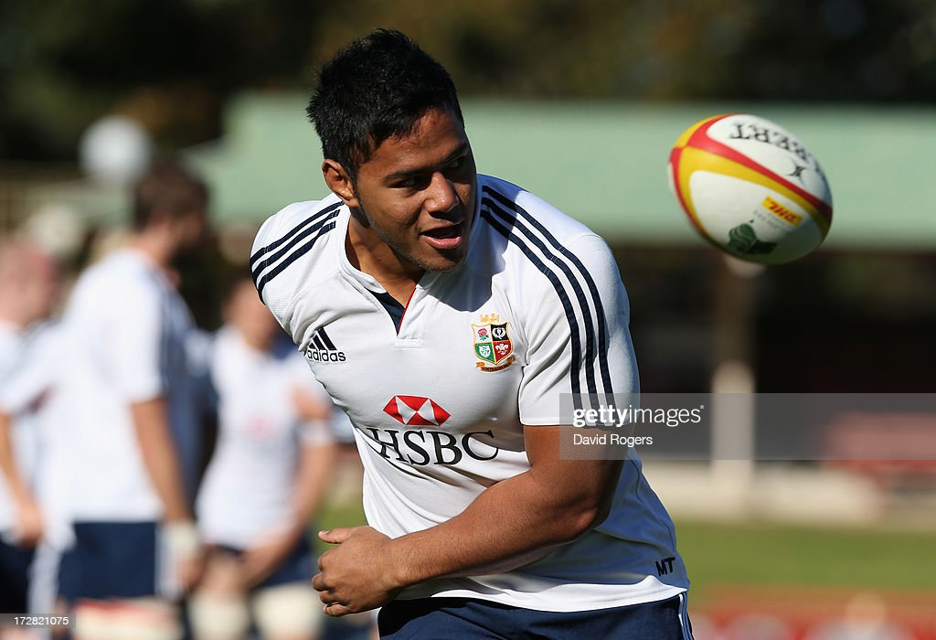 <a gi-track='captionPersonalityLinkClicked' href=/galleries/search?phrase=Manu+Tuilagi&family=editorial&specificpeople=5493832 ng-click='$event.stopPropagation()'>Manu Tuilagi</a> keeps a close watch on the ball during the British and Irish Lions Captain's Run at North Sydney Oval on July 5, 2013 in Sydney, Australia.