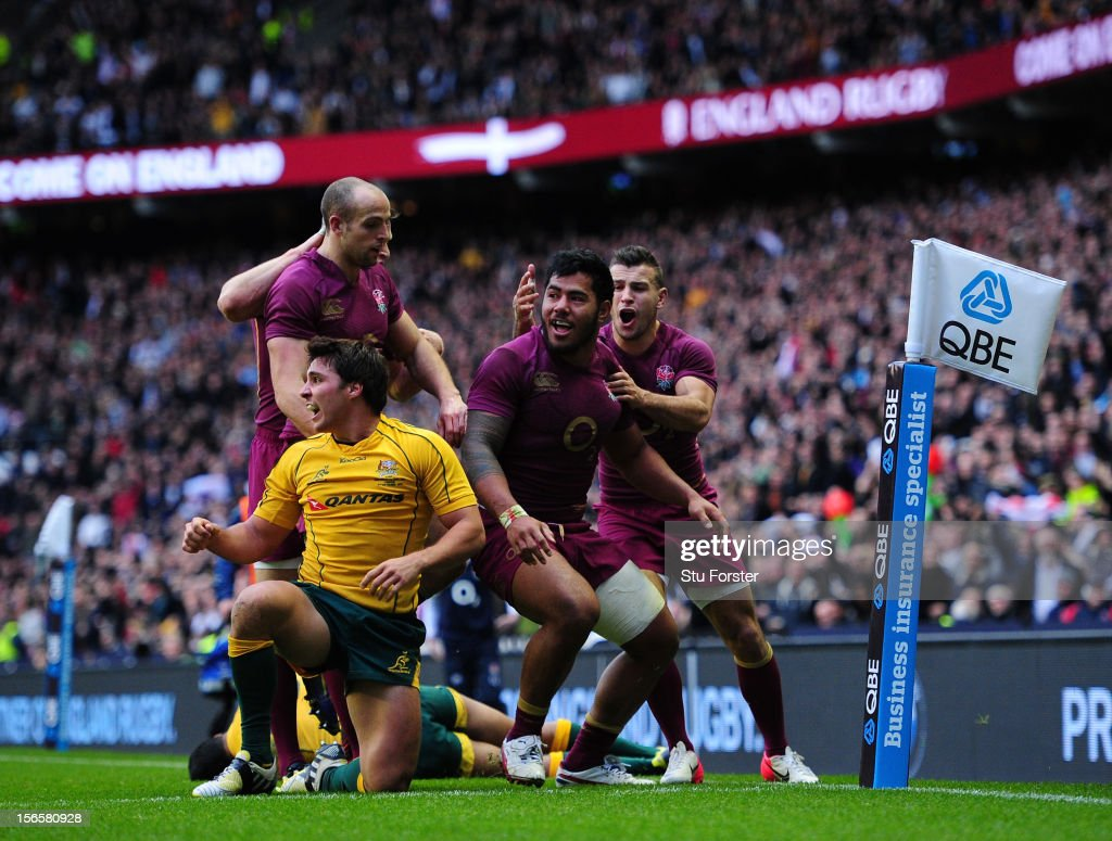 <a gi-track='captionPersonalityLinkClicked' href=/galleries/search?phrase=Manu+Tuilagi&family=editorial&specificpeople=5493832 ng-click='$event.stopPropagation()'>Manu Tuilagi</a> (C) of England celebrates with his team-mates after scoring a try during the QBE International match between England and Australia at Twickenham Stadium on November 17, 2012 in London, England.