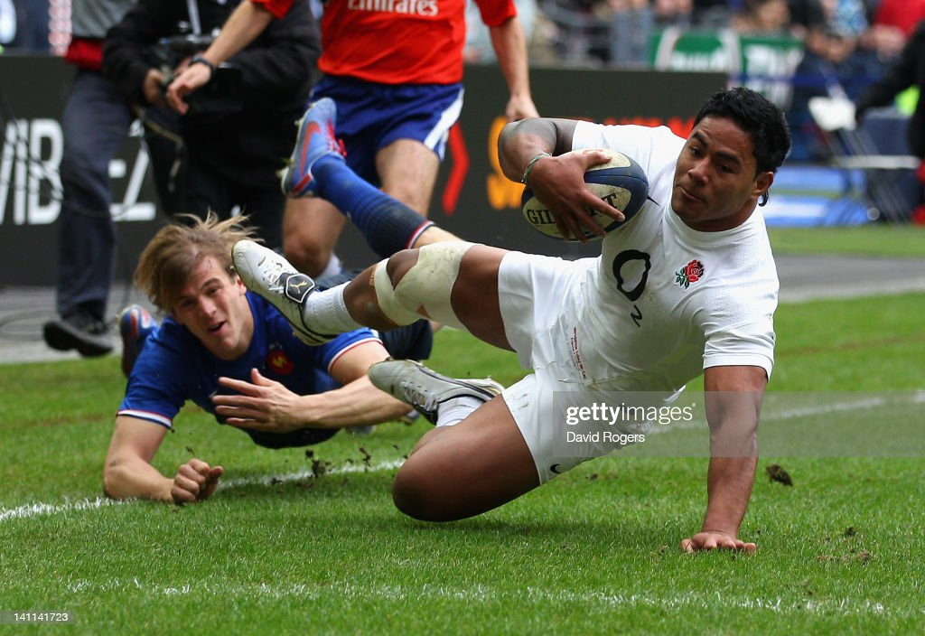 <a gi-track='captionPersonalityLinkClicked' href=/galleries/search?phrase=Manu+Tuilagi&family=editorial&specificpeople=5493832 ng-click='$event.stopPropagation()'>Manu Tuilagi</a> of England evades a tackle by <a gi-track='captionPersonalityLinkClicked' href=/galleries/search?phrase=Aurelien+Rougerie&family=editorial&specificpeople=220239 ng-click='$event.stopPropagation()'>Aurelien Rougerie</a> of France to score the opening try during the RBS 6 Nations match between France and England at Stade de France on March 11, 2012 in Paris, France.