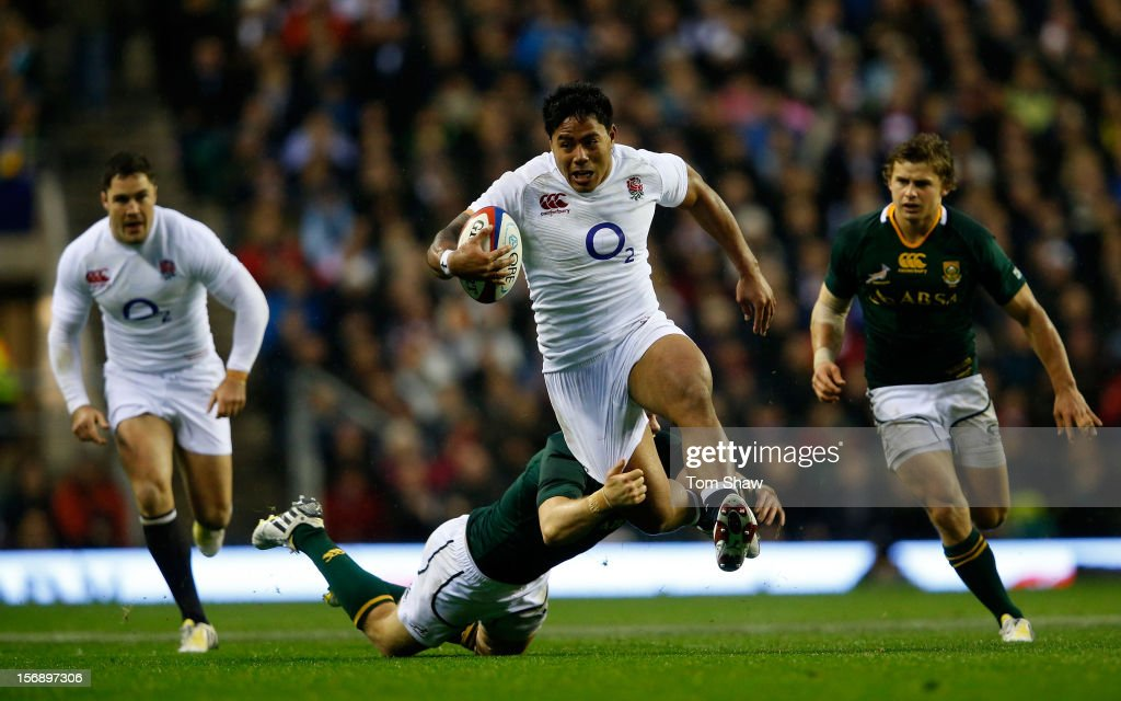 Manu Tuilagi of England evades the tackle of Jean de Villiers of South Africa during the QBE International match between England and South Africa at...
