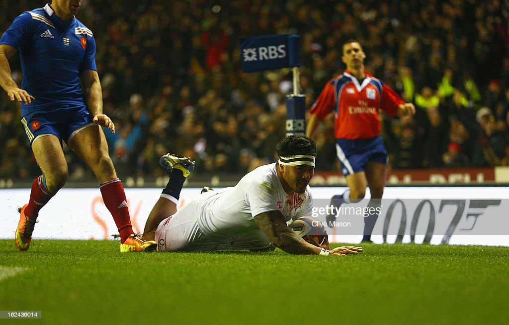 Manu Tuilagi of England goes over to score a try during the RBS Six Nations match between England and France at Twickenham Stadium on February 23...