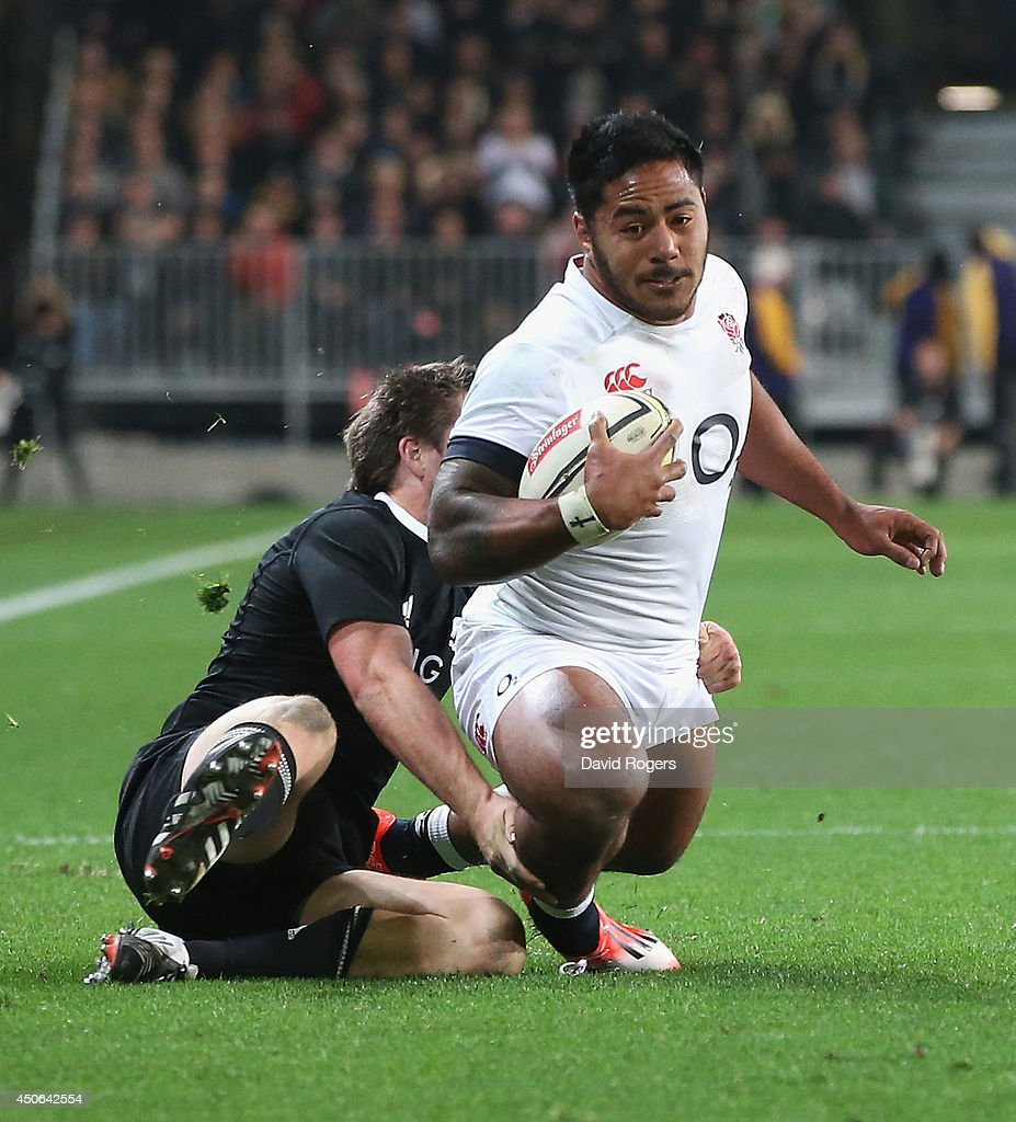 Manu Tuilagi of England is caught by a try saving tackle by All Black fullback, Ben Smith during the International Test Match between the New Zealand All Blacks and England at Forsyth Barr Stadium on June 14, 2014 in Dunedin, New Zealand.