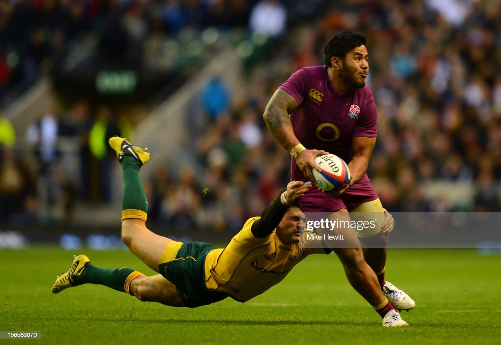 <a gi-track='captionPersonalityLinkClicked' href=/galleries/search?phrase=Manu+Tuilagi&family=editorial&specificpeople=5493832 ng-click='$event.stopPropagation()'>Manu Tuilagi</a> (R) of England is tackled by <a gi-track='captionPersonalityLinkClicked' href=/galleries/search?phrase=Adam+Ashley-Cooper&family=editorial&specificpeople=637621 ng-click='$event.stopPropagation()'>Adam Ashley-Cooper</a> (L) of Australia during the QBE International match between England and Australia at Twickenham Stadium on November 17, 2012 in London, England.