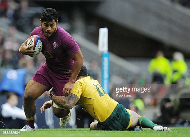 Manu Tuilagi of England is tackled by Nick Cummins of Australia during the QBE international match between England and Australia at Twickenham...