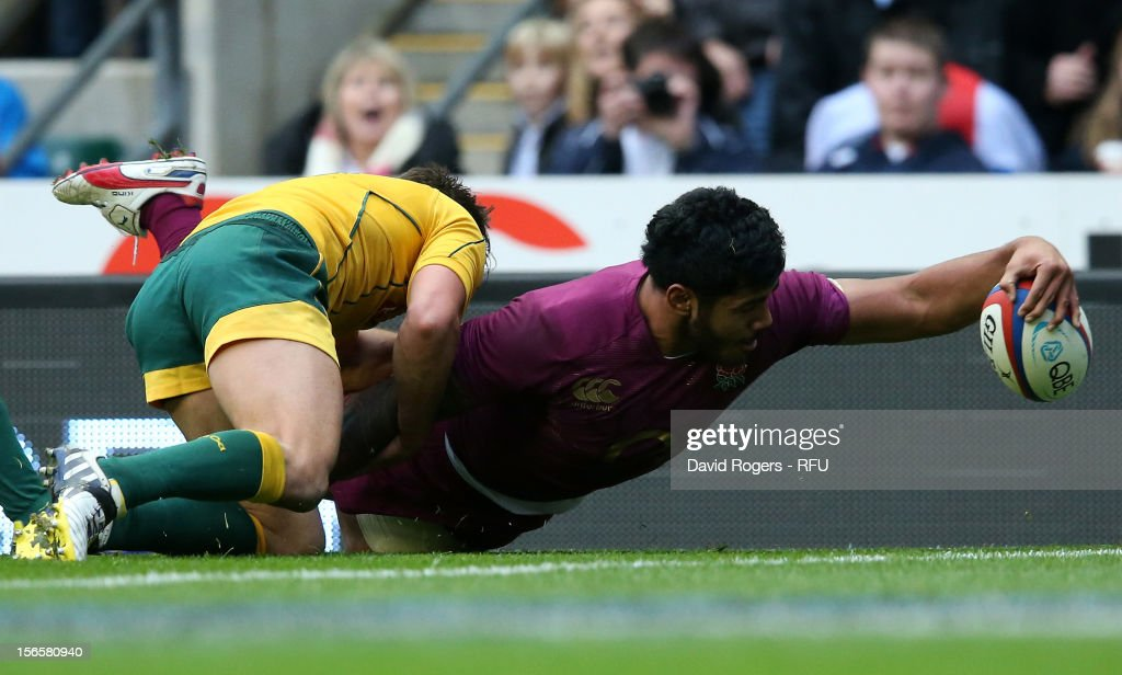 <a gi-track='captionPersonalityLinkClicked' href=/galleries/search?phrase=Manu+Tuilagi&family=editorial&specificpeople=5493832 ng-click='$event.stopPropagation()'>Manu Tuilagi</a> (R) of England scores a try during the QBE International match between England and Australia at Twickenham Stadium on November 17, 2012 in London, England.