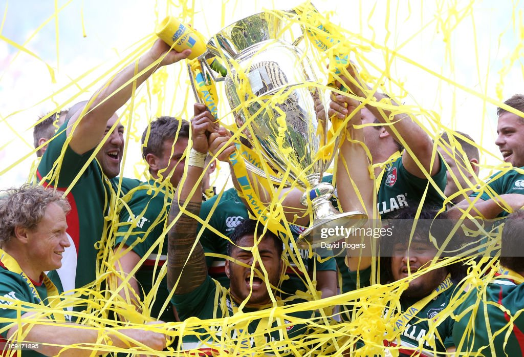 Manu Tuilagi of Leicester celebrates with the trophy following his team's 3717v victory during the Aviva Premiership Final between Leicester Tigers...