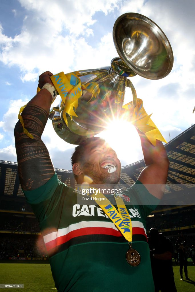 <a gi-track='captionPersonalityLinkClicked' href=/galleries/search?phrase=Manu+Tuilagi&family=editorial&specificpeople=5493832 ng-click='$event.stopPropagation()'>Manu Tuilagi</a> of Leicester celebrates with the trophy following his team's 37-17 victory during the Aviva Premiership Final between Leicester Tigers and Northampton Saints at Twickenham Stadium on May 25, 2013 in London, England.