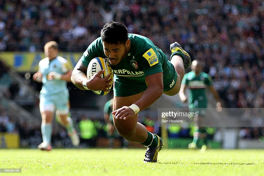 Manu Tuilagi of Leicester dives over the line to score his team's third try during the Aviva Premiership Final between Leicester Tigers and...