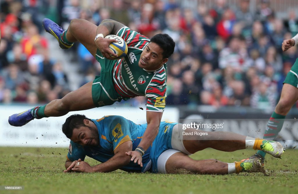Manu Tuilagi of Leicester is brought down by Billy Vunipola during the Aviva Premiership match between Leicester Tigers and London Wasps at Welford...