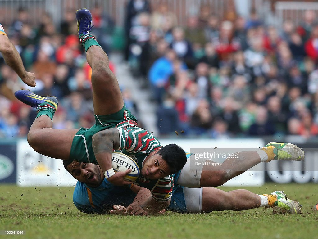 <a gi-track='captionPersonalityLinkClicked' href=/galleries/search?phrase=Manu+Tuilagi&family=editorial&specificpeople=5493832 ng-click='$event.stopPropagation()'>Manu Tuilagi</a> of Leicester is brought down by Billy Vunipola during the Aviva Premiership match between Leicester Tigers and London Wasps at Welford Road on April 14, 2013 in Leicester, England.