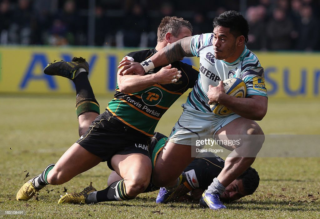 <a gi-track='captionPersonalityLinkClicked' href=/galleries/search?phrase=Manu+Tuilagi&family=editorial&specificpeople=5493832 ng-click='$event.stopPropagation()'>Manu Tuilagi</a> of Leicester is tackled by <a gi-track='captionPersonalityLinkClicked' href=/galleries/search?phrase=George+Pisi&family=editorial&specificpeople=783455 ng-click='$event.stopPropagation()'>George Pisi</a> and Tom May (L) during the Aviva Premiership match between Northampton Saints and Leicester Tigers at Franklin's Gardens on March 30, 2013 in Northampton, England.