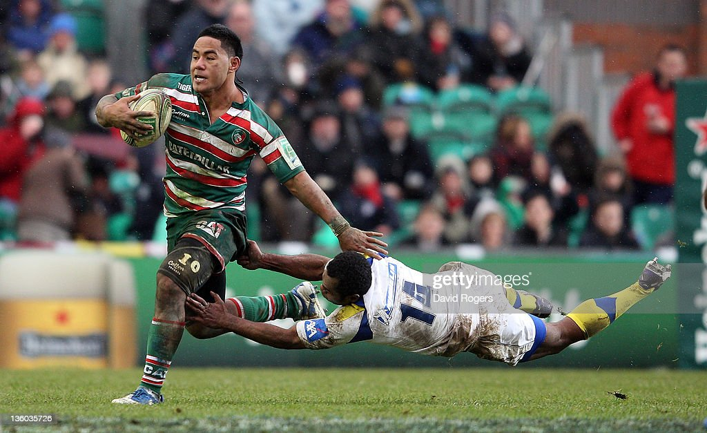 Manu Tuilagi of Leicester is tackled by Sitiveni Sivivatu during the Heineken Cup match between Leicester Tigers and Clermont Auvergne at Welford...
