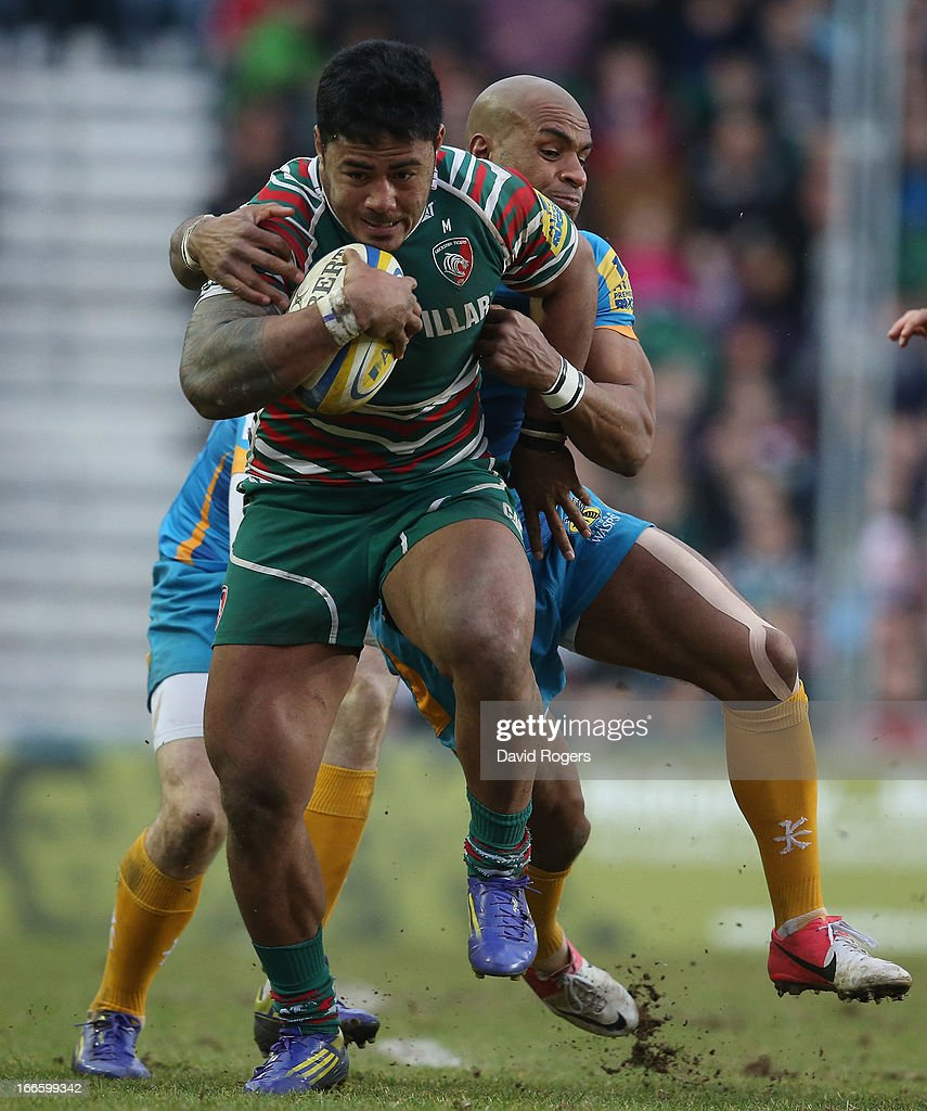 <a gi-track='captionPersonalityLinkClicked' href=/galleries/search?phrase=Manu+Tuilagi&family=editorial&specificpeople=5493832 ng-click='$event.stopPropagation()'>Manu Tuilagi</a> of Leicester is tackled by <a gi-track='captionPersonalityLinkClicked' href=/galleries/search?phrase=Tom+Varndell&family=editorial&specificpeople=561563 ng-click='$event.stopPropagation()'>Tom Varndell</a> during the Aviva Premiership match between Leicester Tigers and London Wasps at Welford Road on April 14, 2013 in Leicester, England.