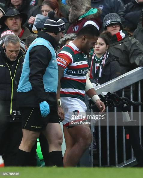 Manu Tuilagi of Leicester limps off the pitch after being injured during the Aviva Premiership match between Leicester Tigers and Saracens at Welford...