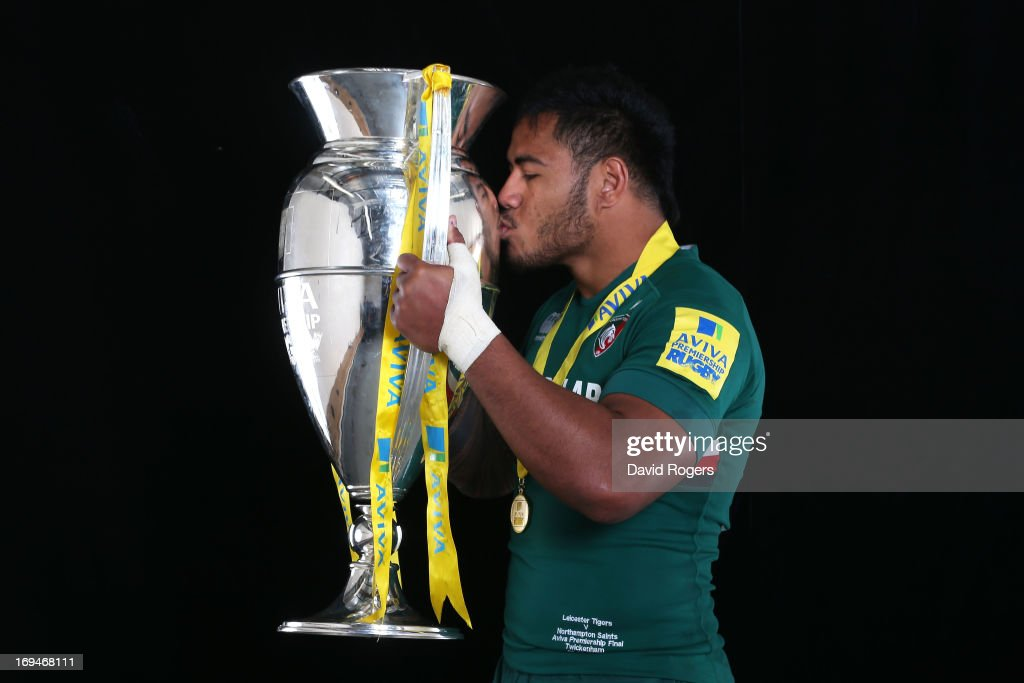 <a gi-track='captionPersonalityLinkClicked' href=/galleries/search?phrase=Manu+Tuilagi&family=editorial&specificpeople=5493832 ng-click='$event.stopPropagation()'>Manu Tuilagi</a> of Leicester poses with trophy following his team's 37-17 during the Aviva Premiership Final between Leicester Tigers and Northampton Saints at Twickenham Stadium on May 25, 2013 in London, England.