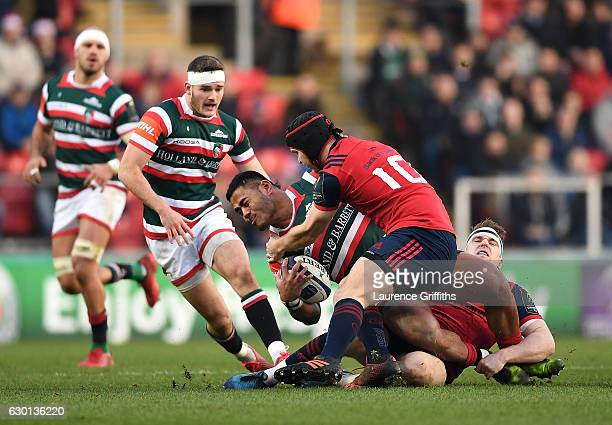Manu Tuilagi of Leicester Tigers is tackled by Tyler Bleyendaal of Munster during the European Rugby Champions Cup match between Leicester Tigers and...