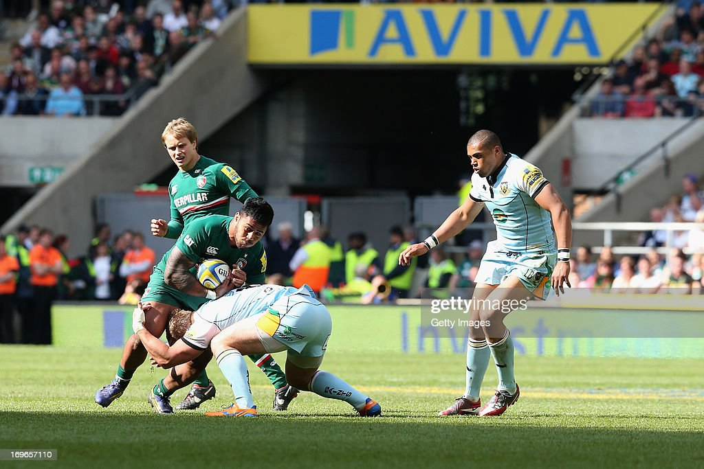 Manu Tuilagi of Leicester Tigers is tackled during the Aviva Premiership Final between Leicester Tigers and Northampton Saints at Twickenham Stadium on May 25, 2013 in London, England.