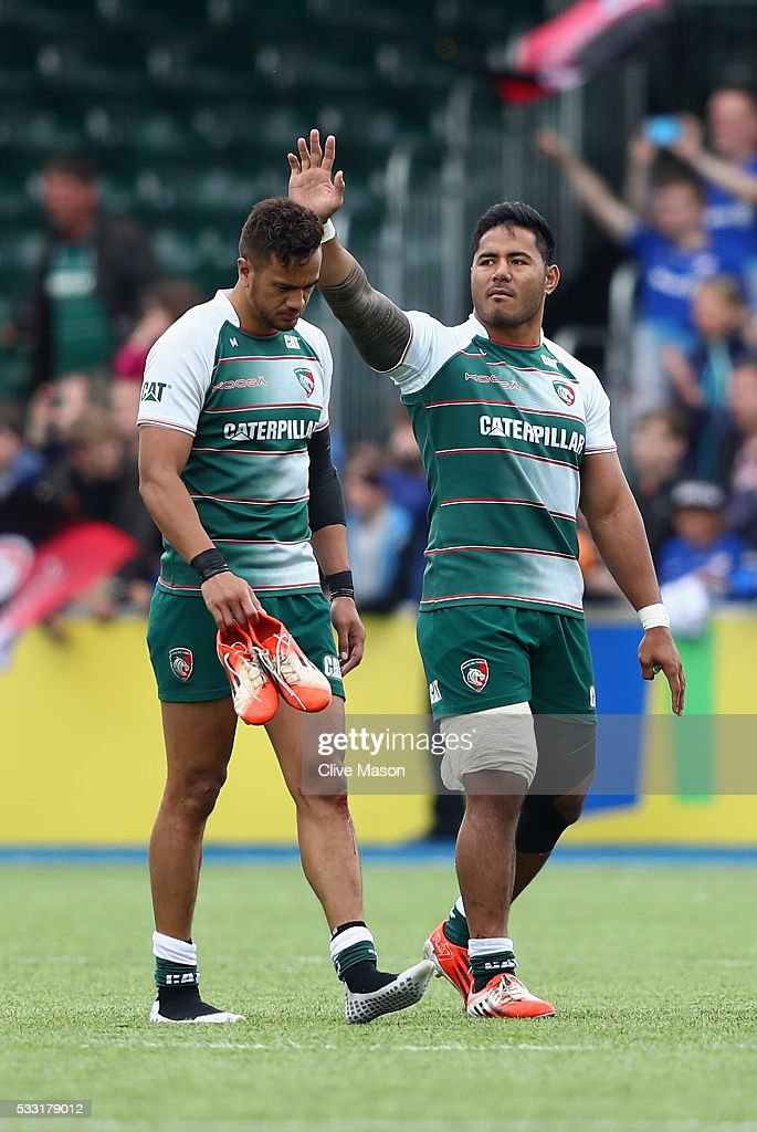 Manu Tuilagi of Leicester Tigers limps around the pitch after hurting his hamstring with team mate Peter Betham after the Aviva Premiership semi...