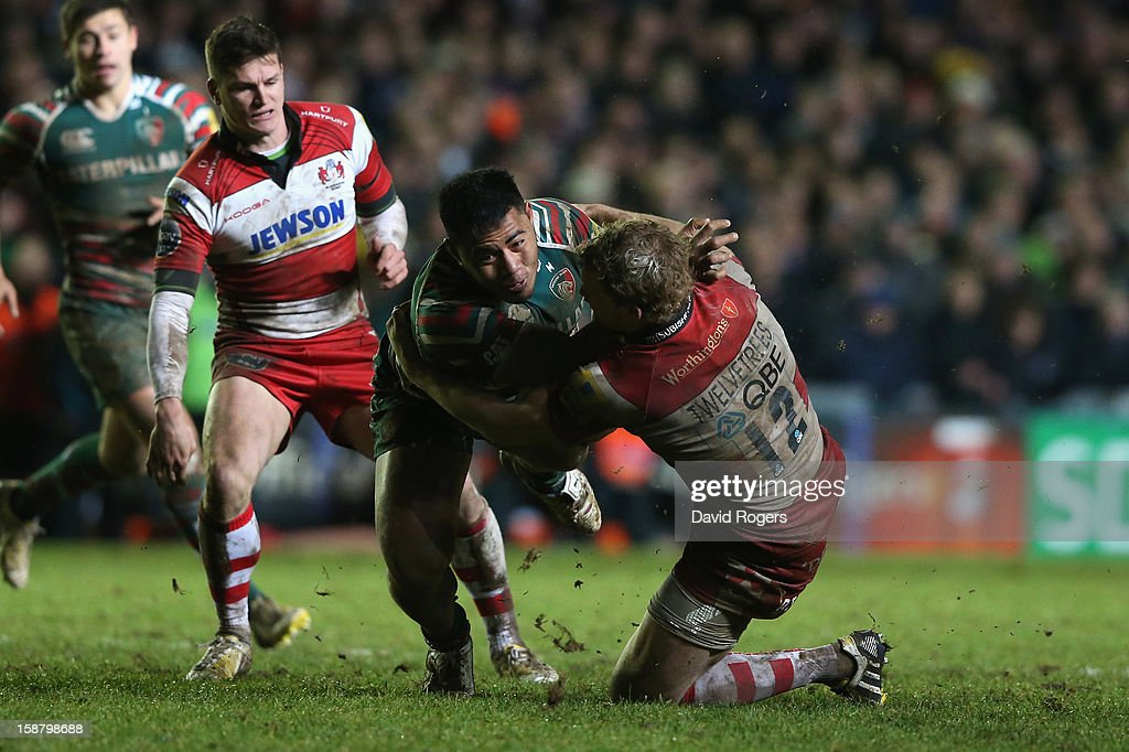 <a gi-track='captionPersonalityLinkClicked' href=/galleries/search?phrase=Manu+Tuilagi&family=editorial&specificpeople=5493832 ng-click='$event.stopPropagation()'>Manu Tuilagi</a> of Leicestser is tackled by <a gi-track='captionPersonalityLinkClicked' href=/galleries/search?phrase=Billy+Twelvetrees&family=editorial&specificpeople=6175351 ng-click='$event.stopPropagation()'>Billy Twelvetrees</a> during the Aviva Premiership match between Leicester Tigers and Gloucester at Welford Road on December 29, 2012 in Leicester, England.
