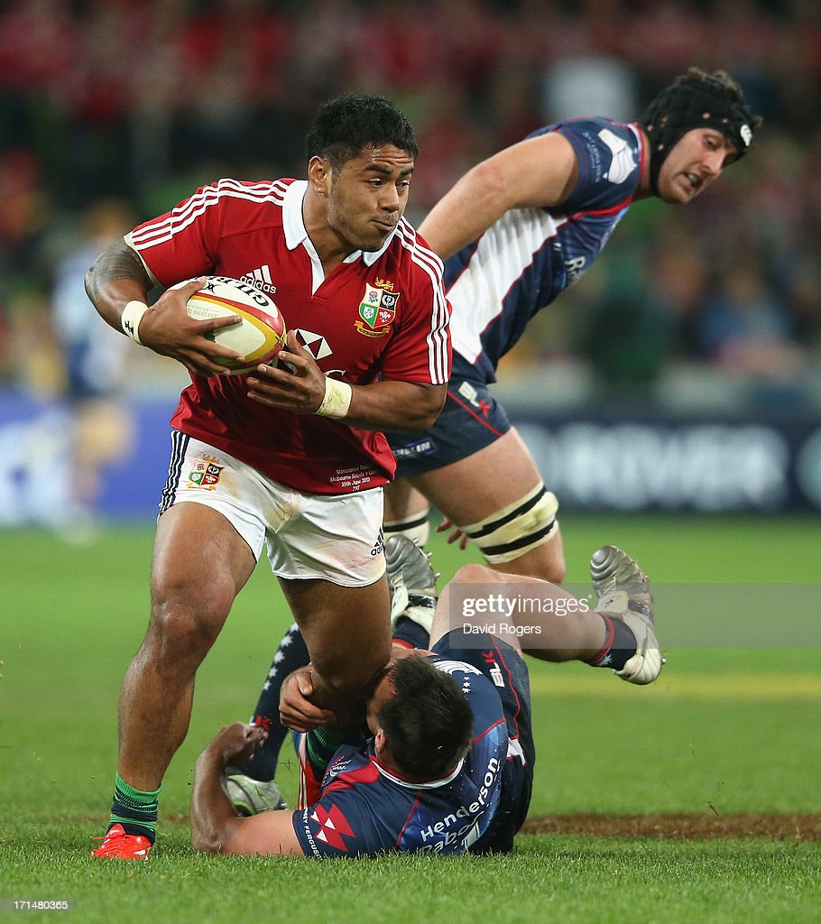 Manu Tuilagi of the Lions is tackled by Nic Henderson during the International Tour Match between the Melbourne Rebels and the British Irish Lions at...