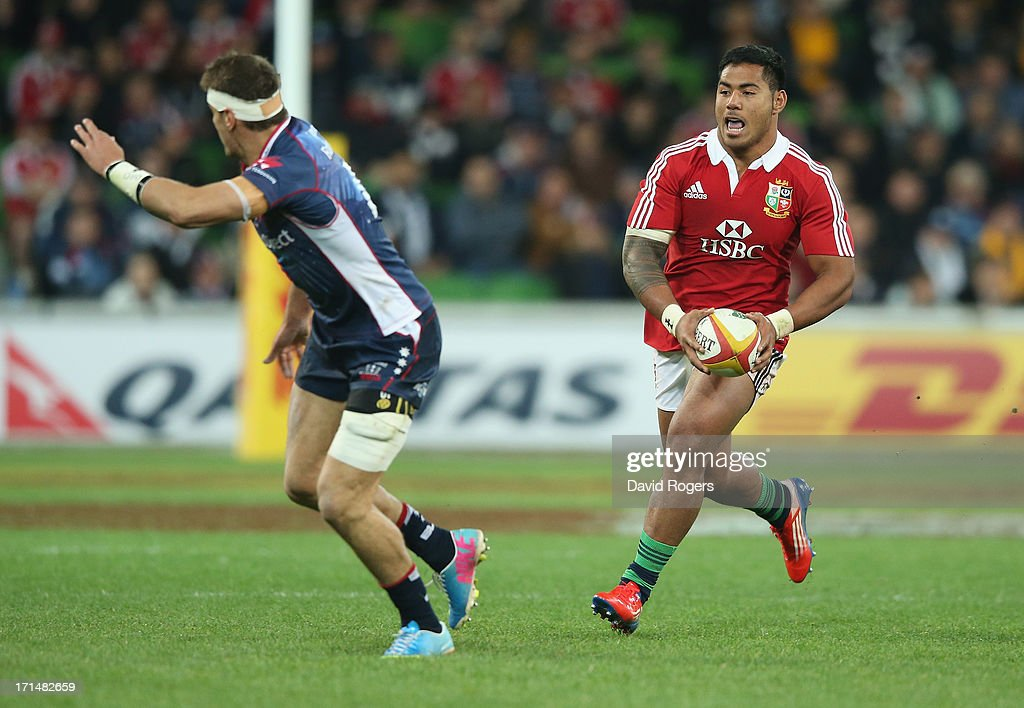 <a gi-track='captionPersonalityLinkClicked' href=/galleries/search?phrase=Manu+Tuilagi&family=editorial&specificpeople=5493832 ng-click='$event.stopPropagation()'>Manu Tuilagi</a> of the Lions takes on Mitch Inman during the International Tour Match between the Melbourne Rebels and the British & Irish Lions at AAMI Park on June 25, 2013 in Melbourne, Australia.
