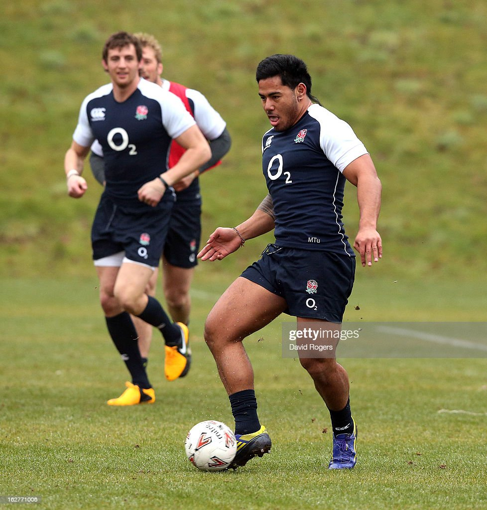 <a gi-track='captionPersonalityLinkClicked' href=/galleries/search?phrase=Manu+Tuilagi&family=editorial&specificpeople=5493832 ng-click='$event.stopPropagation()'>Manu Tuilagi</a> runs with the ball during a warm up game of football during the England training session held at Pennyhill Park on February 26, 2013 in Bagshot, England.