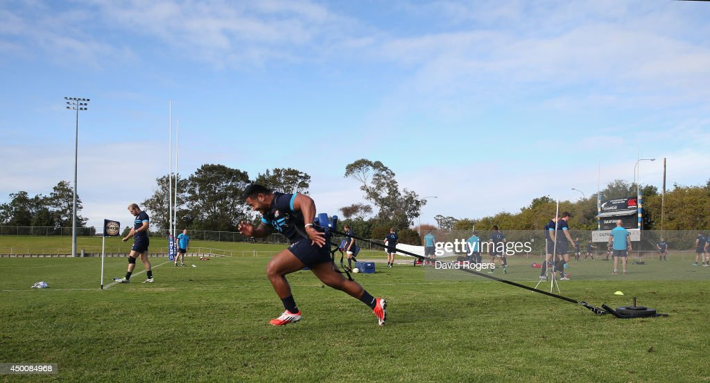 Manu Tuilagi the England centre pulls a weights sled during the England training session held at Takapuna Rugby Club on June 5 2014 in Auckland New...