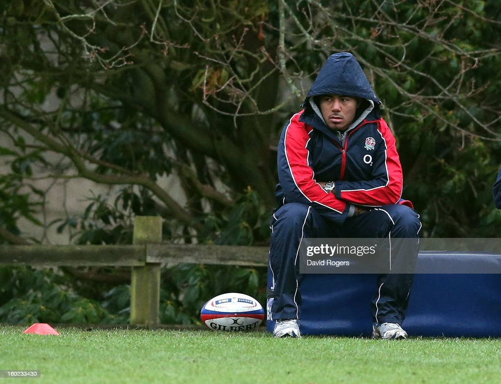 Manu Tuilagi who has an injured ankle and will miss the match against Scotland looks on during the England training session held at Pennyhill Park on...