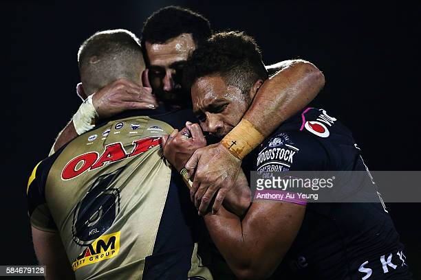 Manu Vatuvei and Ben Matulino of the Warriors put a stop on Bryce Cartwright of the Panthers during the round 21 NRL match between the New Zealand...