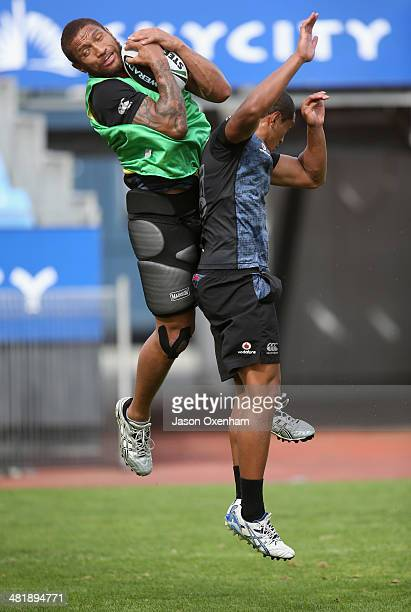 Manu Vatuvei and Glen Fisiiahi of the Warriors compete for the high ball during a New Zealand Warriors NRL training session at Mt Smart Stadium on...