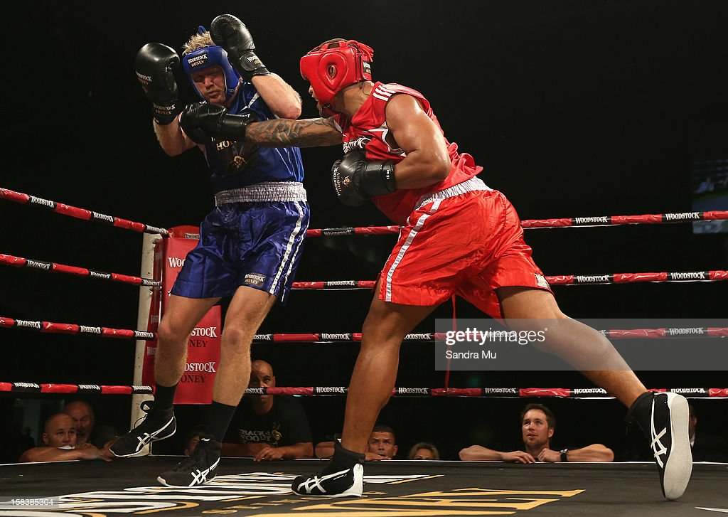 Manu Vatuvei of league (R) punches Eric Murray of rowing during the bout between Eric Murray and Manu Vatuvei during the 2012 Fight for Life at Trusts Stadium on December 15, 2012 in Auckland, New Zealand.