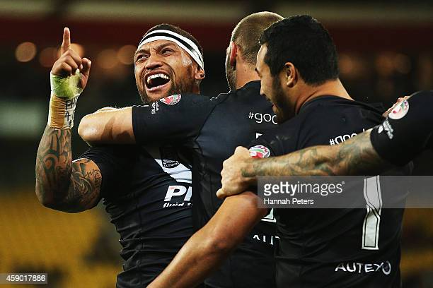 Manu Vatuvei of New Zealand celebrates after scoring a try during the Four Nations Final between the New Zealand Kiwis and the Australian Kangaroos...